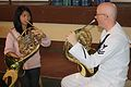 US Navy 110712-N-MA031-284 Musician 2nd Class Anthony Smouse speaks to a student from Benguet State University during a masterclass on technique an.jpg