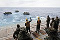 US Navy 111006-N-MW330-131 Sailors assigned to the forward-deployed amphibious dock landing ship USS Germantown (LSD 42) and Marines assigned to th.jpg