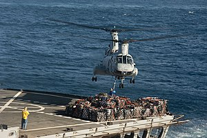US Navy 120104-N-PB383-021 A helicopter transfers cargo between ships.jpg