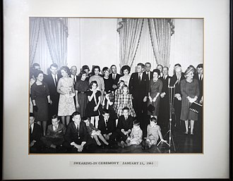 Stewart Udall - Udall (rear) standing next to Mrs. John F. Kennedy at the president's Swearing In Ceremony, January 21, 1961.