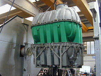 Rotational molding - Unloading a molded polyethylene tank in a Shuttle machine