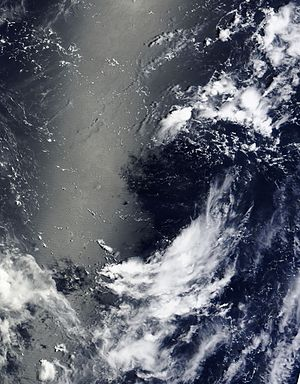 Cold-core low - An upper tropospheric cyclonic vortex in the western North Pacific, showing high level cloud tops being sucked in.