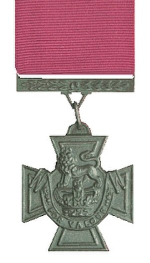 "Victoria Cross - Obverse of the cross. Ribbon: 1½"" (38 mm), crimson (blue ribbon for naval awards 1856–1918)."