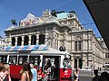 Vienna opera house with red tram 2 (5160226792).jpg