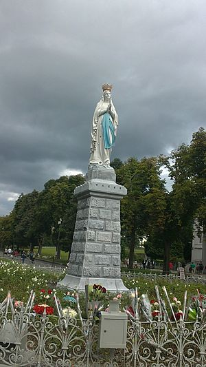 Our Lady of Lourdes - The venerated image of Our Lady of the Rosary granted a Canonical Coronation by Pope Pius XI on 3 July 1876. During that same year, an oversized golden laurel wreath was placed at the base as well as a stellar halo was attached to the head of the image; both no longer present.