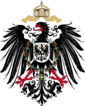 Shield containing a black, one-headed, rightward-looking eagle with red beak, tongue and claws. On its breast is a shield with another eagle. Over its head is an imperial crown with two crossing ribbons.