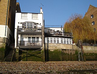 historic public house on the banks of the Thames at Wapping