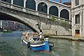 Water transport in Venice at Rialto bridge.jpg