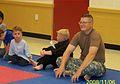 We-Aiden Seth Dad at karate.jpg