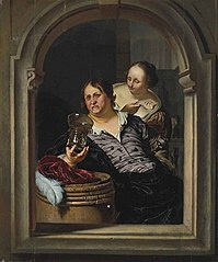 A Man Drinking and a Woman Offering Him a Fish