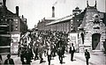 Workers leave the Pullman Palace Car Works, 1893.jpg
