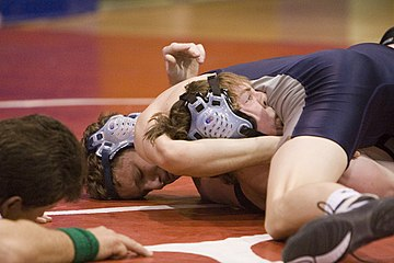 A fall, also known as a pin, occurs when any part of both shoulders or both scapulae (shoulder blades) of the defensive wrestler is held in continuous contact with the mat for a specified amount of time (in collegiate wrestling for one second). Wrestling falconfrenzy065.jpg