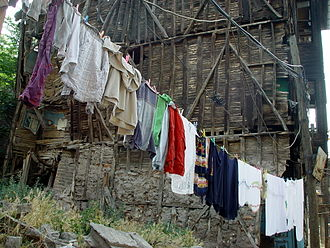 Zeyrek - Clothes drying in ruins of a wooden house