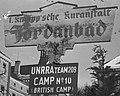 """""""Jordanbad"""" """"UNRRA TEAM 209"""" """"CAMP No. 10 (BRITISH CAMP)"""" SIGN DETAIL, FROM- Tehuis in Duitsland voor Joodse mensen, die ontslagen zijn uit concentratiekampe, Bestanddeelnr 901-5573 (cropped).jpg"""