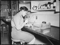 """Pfc. Johnnie Mae Welton, Negro WAC, laboratory technician trainee, conducts an experiment in the serology laboratory sf - NARA - 531360.tif"