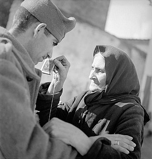 Greco-Italian War - A Greek woman sees her son depart for the Albanian front.