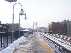 167th Street (IRT Jerome Avenue Line) - Two trains running on the 4 service (one arriving, one leaving) at  the 167th Street Station, facing southbound.