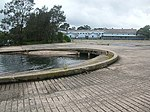 1740 - Rathmines Park, former RAAF Seaplane Base - Slipways and stormwater channel (forground), original Repair Depot hanger & relocated airmen's sleeping huts (background), concrete apron (centre). (5054666b11).jpg