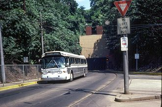 South Busway - A bus exits the newly paved Mount Washington tunnel onto the South Busway in 1982
