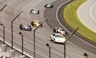 1997 Indianapolis 500 - The pace cars leads the field through turn one on Monday during the parade lap.
