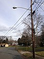 2014-12-30 12 49 48 Utility pole and a sodium-vapor street light along Bittersweet Road in Ewing, New Jersey.JPG