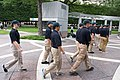 2015 Law Enforcement Explorers Conference law enforcement explorers carrying wreath while others stand in formation.jpg
