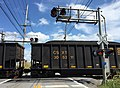 2016-08-25 14 58 14 A freight train using a railroad crossing along eastbound West Virginia State Route 901 (Hammonds Mill Road) between Ridge Road and Little Georgetown Road in North Mountain, Berkeley County, West Virginia.jpg