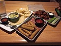 2017-08-31 21 23 34 Appetizers (Chips with spinach-artichoke dip, mozzarella sticks, and honey-bbq buffalo wings) at the Applebee's on Virginia State Route 7 (Harry Byrd Highway) in Countryside, Loudoun County, Virginia.jpg