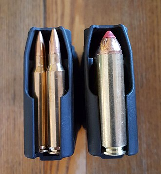 STANAG magazine - STANAG magazines loaded with .223 Rem (left) and .450 Bushmaster (right)