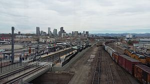 38th & Blake station - View of station and Denver skyline from pedestrian bridge during A-Line opening weekend