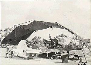 No. 76 Squadron RAAF - A No. 76 Squadron P-40 Kittyhawk undergoing maintenance at Kiriwina in January 1944