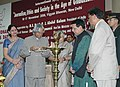 A.P.J. Abdul Kalam lighting the lamp to inaugurate the two day International Symposia on Media Matters, organised by the Press Council of India (PCI) on the National Press Day, in New Delhi on November 16, 2006.jpg