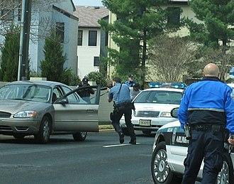 Arlington County Police Department - ACPD policemen apprehending a bank robber in 2006.