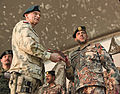 A Polish commander, left foreground, presents an award to the incoming commander of the Jordanian Armed Forces, Task Force 222 during a change of command ceremony at Bagram Airfield in Parwan province 131221-A-RU942-140.jpg