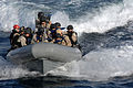 A U.S. Navy visit, board, search and seizure team from the guided-missile destroyer USS Farragut (DDG 99) rides in a rigid-hull inflatable boat during a training exercise 130118-N-BQ817-083.jpg