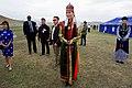 "A Woman in Traditional Mongolian Dress Awaits Secretary Kerry as He Arrives at a Field Outside Ulaanbaatar for a ""Mini-Nadaam"" (26931936384).jpg"