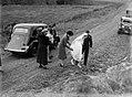 A bride walking across a gravel road (AM 75864-1).jpg