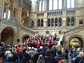 A choir of Natural History Museum, Science Museum and Victoria and Albert Museum staff members sing carols in the central hall of the Natural History Museum 03.jpg