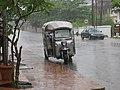A typical Bangkok style tuk tuk in LP, and rain! (14605627055).jpg