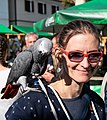 A young lady with a parrot (43478659560).jpg