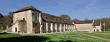 Photographie contemporaine du corps de bâtiments d'une abbaye.