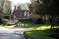 Abbess Roding roadside house and St Edmund's Church entrance - Essex England.jpg