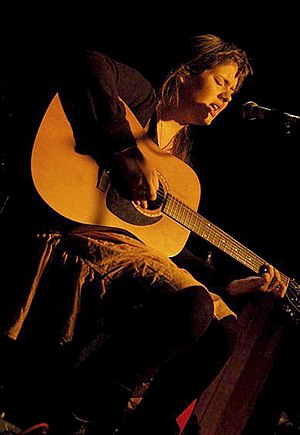 Adele - Teenaged Adele performing on an acoustic guitar in Kilburn, London, in 2007