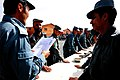 Afghan National Police instructor administers the Afghan police oath during a graduation ceremony at Regional Training Center, Bamyan.jpg