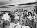 After the movies, snack bar at bowling alleys is crowded with younger generation. Inland Steel Company, Wheelwright... - NARA - 541509.tif
