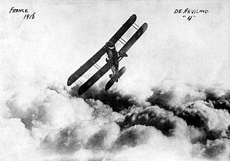 George Kenney - DH.4 above the clouds in France. Kenney flew this aircraft in Texas, and later developed techniques for mounting machine guns on the wings.