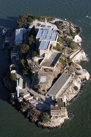 Recreation Yard (Alcatraz) - Aerial view showing the main cellblock, dining hall area, and the yard in front of it and just to the right.