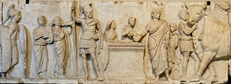 Equites - A Roman senior officer (centre) of the time of Polybius, as depicted on a bas-relief from the Altar of Cn. Domitius Ahenobarbus, ca. 122 BC. Probably a tribunus militum (joint legionary commander), the officer wears a decorated bronze cuirass, pteruges, mantle, and Attic-style helmet with horsehair plume. The sash around his cuirass probably denoted knightly rank. In the Republican army, tribuni were elected by the comitia centuriata (main people's assembly) from the members of the equestrian order. Musée du Louvre, Paris.