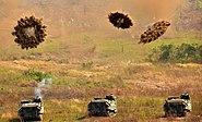 Amphibious Assault Vehicles fire smoke grenades