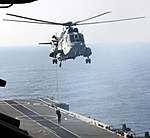 An Indian Navy commando slithering from a Sea King helicopter during TROPEX-2012.jpg